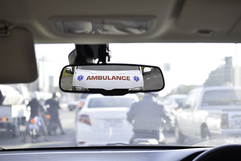 Ambulance in rear-view mirror