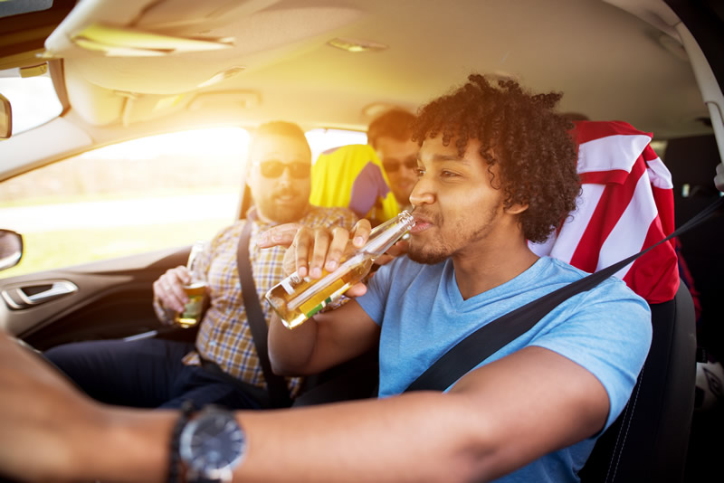 Driver and passengers drinking in vehicle