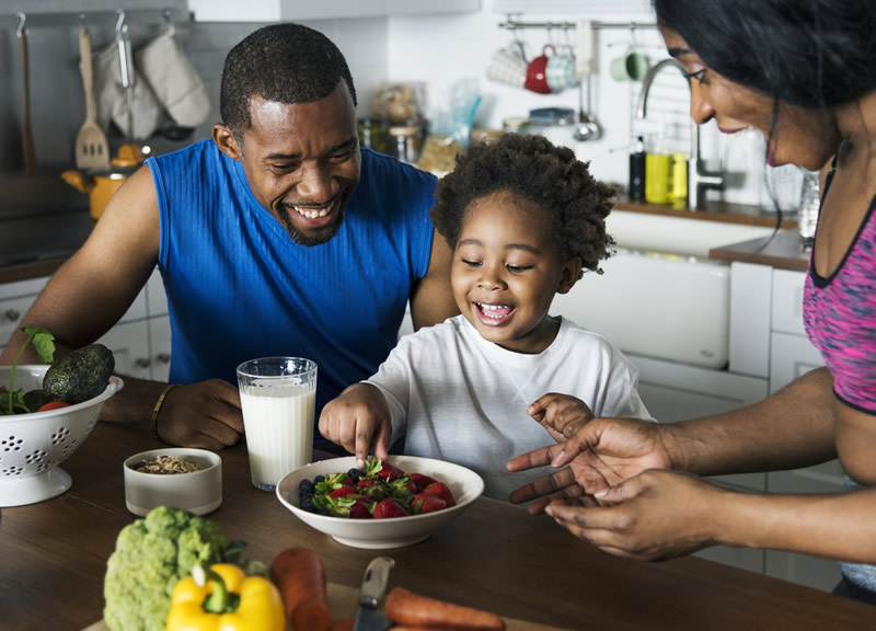 Family encouraging healthy eating habits