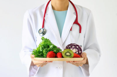 Healthy fruits and vegetables served by healthcare professional