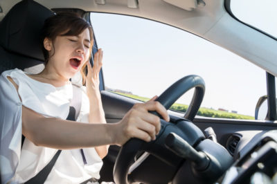 Yawning driver behind wheel